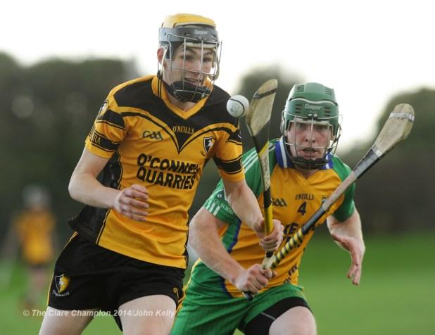 Paraic O Loughlin of Clonlara in action against Ciaran Devitt of Inagh-Kilnamona during their Junior A final at Clarecastle. Photograph by John Kelly.