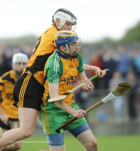Paul O Looney of Inagh-Kilnamona in action against Ger Powell of Clonlara during their Junior A final at Clarecastle. Photograph by John Kelly.