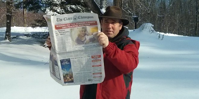 Martin McDonnell, originally from Kilkee, enjoys a read of The Clare Champion in snowy Ontario.