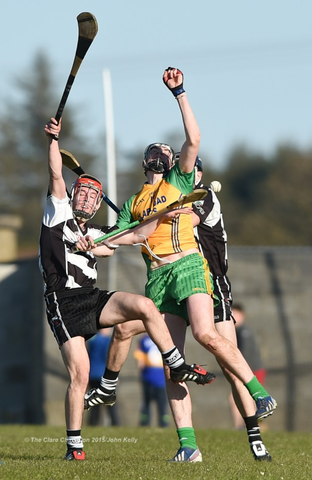 Gearoid Ryan of Clarecastle in action against David Fitzgerald of Inagh-Kilnamona during their Clare Champion Cup game in Inagh. Photograph by John Kelly.