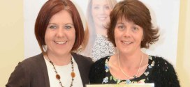 Niamh McMahon receives her Gold cert from Weightwatcher leader, Kathleen Shannon, after maintaining her goal weight for four weeks.