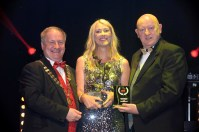 Kathleen Browne, Shannon Musical Society receives the Best House Management Award Gilbert Section for their production of Legally Blonde from Colm Moules, President and Seamus Power, Vice-President at the AIMS (Association of Irish Musical Societies) annual music theatre awards in the INEC, Killarney at the weekend. Photo: Don MacMonagle