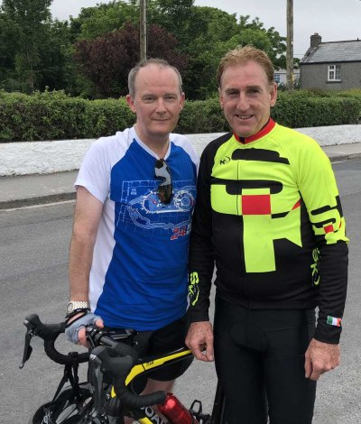 Clare Champion general manager, John Galvin, with Seán Kelly at the finish of the cycle.