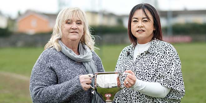 Tina Kenneally and Fiona Moloney, mothers of Shay and Jack holding the new rugby cup at the Ennis Rugby Club. Photograph by Paul Corey.