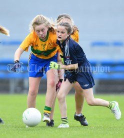 Ella Casey of Barefield NS in action against Amy Butler of Knockanean NS during their Division 1 LGFA Ladies Football Primary Schools final at Cusack park. Photograph by John Kelly