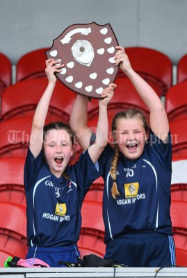 Barefield NS joint captains Lucy Power and Lyndsay Clarke lift the trophy following their win over Knockanean NS in the Division 1 LGFA Ladies Football Primary Schools final at Cusack park. Photograph by John Kelly