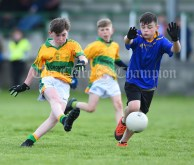 Brian Keane of Carrigaholt/Moveen in action against Darragh O Leary of Carron/New Quay,Ballyvaughan/Fanore during their Primary Schools Div 3 Football 11-Aside final at Kilrush. Photograph by John Kelly