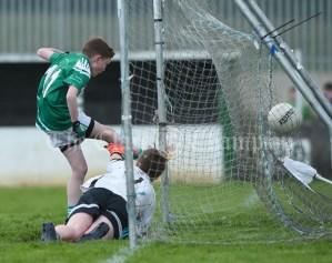 Jack Flavin of Kilrush scores a goal despite Damien Mc Inerney of Doonbeg during their Primary Schools Div 2 Football 13-Aside final at Kilrush. Photograph by John Kelly