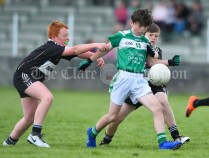 Josh Mc Inerney of Kilrush in action against Darragh O Sullivan and Cullan Griffin of Doonbeg during their Primary Schools Div 2 Football 13-Aside final at Kilrush. Photograph by John Kelly