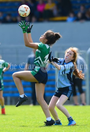 Lakisha Isiesi of St Senan's Kilrush in action against Ava Maher of Cooraclare/Cree/Clohanbeg during their Division 2 LGFA Ladies Football Primary Schools final at Cusack park. Photograph by John Kelly