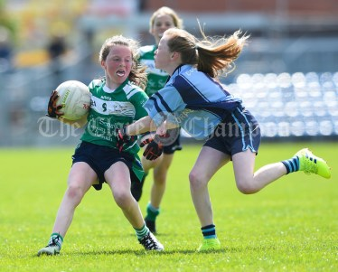 Aisling Crowe of St Senan's Kilrush in action against Eadaoin Mc Namara of Cooraclare/Cree/Clohanbeg during their Division 2 LGFA Ladies Football Primary Schools final at Cusack park. Photograph by John Kelly