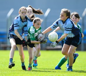 Leah Daly of St Senan's Kilrush in action against Aisling Kelly and Marian Lynch of Cooraclare/Cree/Clohanbeg during their Division 2 LGFA Ladies Football Primary Schools final at Cusack park. Photograph by John Kelly