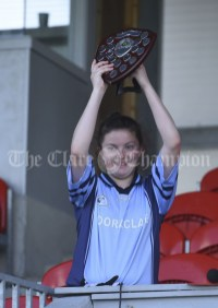 The victorious captain Ava Hehir of Cooraclare/Cree/Clohanbeg lifts the spoils following their Division 2 LGFA Ladies Football Primary Schools final at Cusack park. Photograph by John Kelly