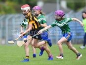 Tara Murnane of Ogonelloe in action against Grainne Mc Mahon and Shauna O Callaghan of Stonehall/Ballycar during their Schools Division 4 camogie final at Cusack Park. Photograph by John Kelly