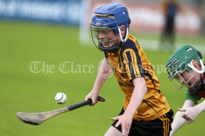 120619 Clooneys Tommy McNamara can't stop Clonmoneys Damien Lyne during the Division 4 Hurling Clare Primary School Finals .Pic Arthur Ellis