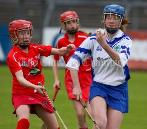 120619 Cratloes Jennifer Mullen under pressure from Crusheens Aine Sheedy the Camogie Division 2 final.Pic Arthur Ellis