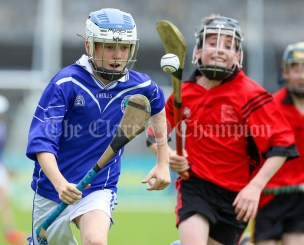 120619 Cratloes Gareth Murphy gets away from Ennis NS's Tom Kavanagh in the Division 1 final.Pic Arthur Ellis