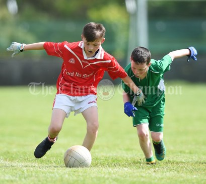 Dylan O Neill of Kilmurry Mc Mahon/Labasheeda in action against Micheal Twomey of Rineen during their Primary Schools Div 4 Football 9-Aside final at Kilrush. Photograph by John Kelly