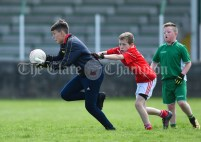 Coilin Hayes of Rineen in action against Eoin Davis of Kilmurry Mc Mahon/Labasheeda during their Primary Schools Div 4 Football 9-Aside final at Kilrush. Photograph by John Kelly