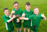 Double set of twin brothers; Michael and Sean Twomey and Niall and Gavin Twomey, (centre) of victorious Rineen, following their Primary Schools Div 4 Football 9-Aside final at Kilrush. Photograph by John Kelly