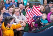 US flags are distributed in the crowd ahead of a walkabout by Eric and Don Junior Trump in Doonbeg Village. Photograph by John Kelly
