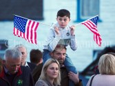 A boy waits with his flags in the crowd ahead of a walkabout by Eric and Don Junior Trump in Doonbeg Village. Photograph by John Kelly