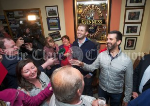 Eric and Don Junior Trump address the locals in Comerford's bar during a walkabout in Doonbeg Village. Photograph by John Kelly