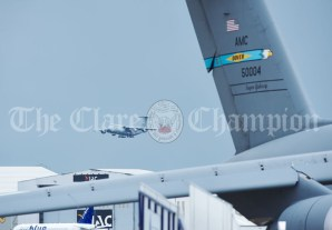 The scene at Shannon Airport as a a US Airforce Super Galaxy plane descends for landing on Monday with a cargo including personnel, equipment and dogs. Photograph by John Kelly.
