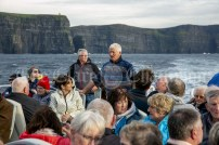 230819 Joe Queally chats to the passengers on the RNLI fund raising cruise to the Cliffs of Moher and Inis Oir with Doolin2Aran Ferries Star of Doolin on Friday evening.Pic Arthur Ellis.