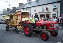 Michael and Michelle Downes with a vintage thrashing machine during the Cultural Parade as part of the annual Festival Of Fun in Kilmihil. Photograph by John Kelly