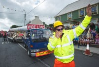 Padraig Walsh of the Glenmore Windfarm group helps a truck negotiate a corner during the Cultural Parade as part of the annual Festival Of Fun in Kilmihil. Photograph by John Kelly