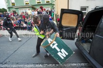 A man is apprehended following and impromptu ATM Bank Raid underway during the Cultural Parade as part of the annual Festival Of Fun in Kilmihil. Photograph by John Kelly