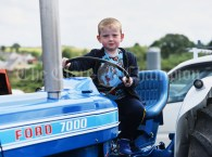 Miltown's Adam Burke takes a shine to a vintage Ford 7000 during the Vintage Rally and field day as part of the annual Festival Of Fun in Kilmihil. Photograph by John Kelly