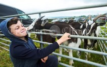 Ballynacally's Shane Sheehan takes a shine to the kid goats at Kildysart Show. Photograph by John Kelly