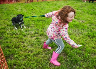 Katelyn Doocey of Kilkee struggles with her striking dog in the parade ring at Kildysart Show. Photograph by John Kelly