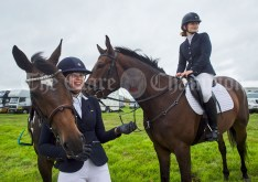 Cousins Andrea and Karen O Brien wait their turn to compete in the showjumping at Kildysart Show. Photograph by John Kelly