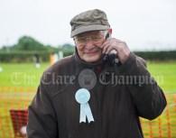 Honorary President John Mc Goldrick takes a call at Kildysart Show. Photograph by John Kelly