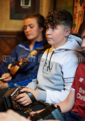 Nathan Keane Thompson playing in a sessiun in Buggles as part of the Kilrush Traditional Music & Set Dancing Festival. Photograph by John Kelly