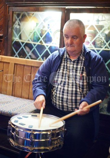 Aidan Vaughan on percussion during a sessiun in Buggles as part of the Kilrush Traditional Music & Set Dancing Festival. Photograph by John Kelly
