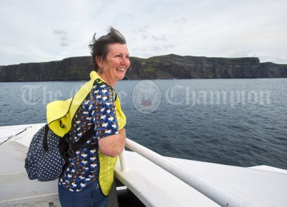 Teresa Connellan takes in the views of the Cliffs of Moher during the Romantic RNLI Cruise held in association with Bill O Brien's Doolin Ferry Company. Photograph by John Kelly