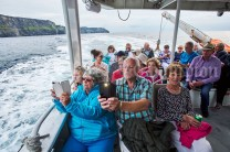 Passengers enjoying sea level views of the Cliffs Of Moher during the Romantic RNLI Cruise held in association with Bill O Brien's Doolin Ferry Company. Photograph by John Kelly
