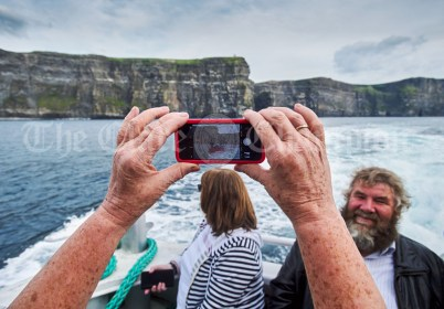 The Cliffs of Moher are framed carefully during the Romantic RNLI Cruise held in association with Bill O Brien's Doolin Ferry Company. Photograph by John Kelly