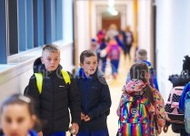 Children seek out their classrooms during the first day of school at the newly built Ennis CBS primary school. Photograph by John Kelly