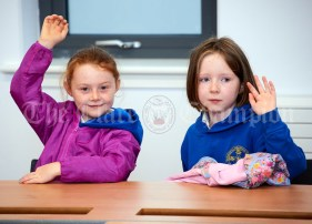 Third class pupils Laoise Cunningham and Siun Purcell during the first day of school at the newly built Ennis CBS primary school. Photograph by John Kelly