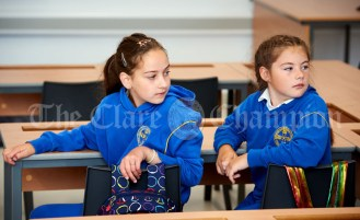 Second class pupils Wiktoria Stachora and Wictoria Morava settle in during the first day of school at the newly built Ennis CBS primary school. Photograph by John Kelly