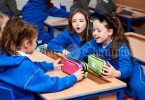 Sophie Mc Quaid and Emily Noonan discuss pencil cases with their friends during the first day of school at the newly built Ennis CBS primary school. Photograph by John Kelly
