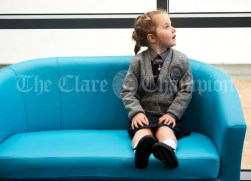 Junior infant Eva Moloney patiently waits to be escorted to her classroom during the first day of school at the newly built Ennis CBS primary school. Photograph by John Kelly