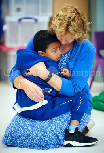 Deputy Principal Mary Murphy comforts junior infant Juan Plathottathil Savy during his first day of school at the newly built Ennis CBS primary school. Photograph by John Kelly