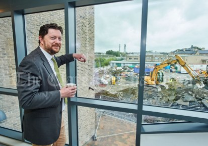 Principal Dara Glynn looks out on the ongoing works during the first day of school at the newly built Ennis CBS primary school. Photograph by John Kelly