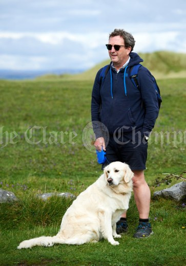 Eamon Lynch of Killaloe with Finn, about to head off on the Burren Ramble in aid of the RNLI at Fanore. Photograph by John Kelly